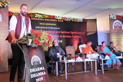 Simmons speaking at conference